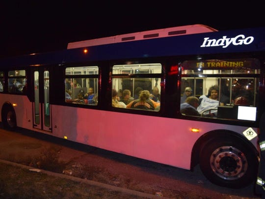 Displaced residents stayed warm in an IndyGo bus after a fire at the Indy Hotel early Wednesday.