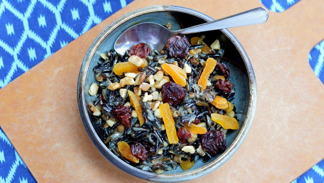 Dried cherries give this bowl of wild rice porridge a distinctive Wisconsin touch.