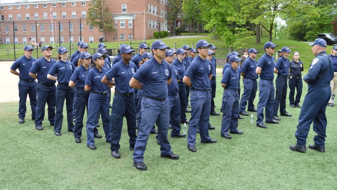 Westchester County police Sgt. Vincent Antonecchia speaks to 39 Westchester Youth Police Academy students about aviation in law enforcement at Iona College, May 24, 2017.