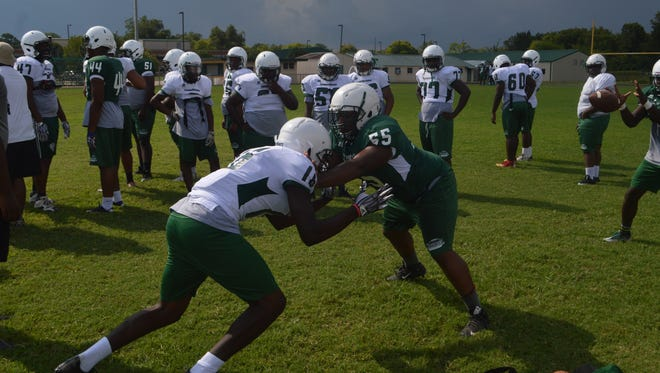 Peabody sophomore Cliron Price (55) blocks his teammate during practice Tuesday. The Warhorses will face Franklin Parish in the Cenla Jamboree Friday.