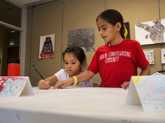 Jordan Gamez, right, helps Aria Richter with her perspective drawing during the Elementary Art Adventure class with the Naples Art Association at The von Liebig Art Center on Tuesday, Oct. 11, 2016. The home schooled students worked on perspective and shading, culminating in a finished drawing of their choosing.