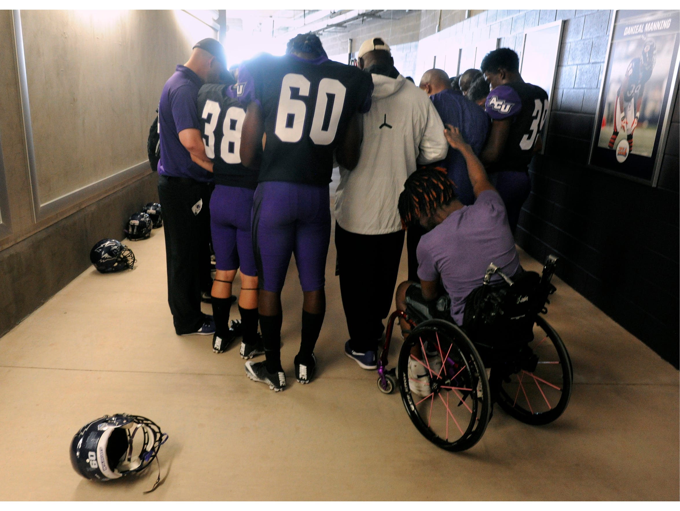 Outside the Wildcat locker room, J.R. Hall puts a hand