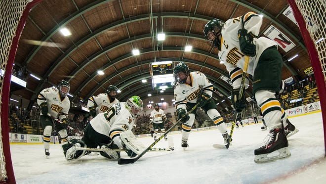 Vermont goalie Madison Litchfield (30) looks for the puck during a women's hockey game between the UConn Huskies and the Vermont Catamounts at Gutterson Fieldhouse last season.