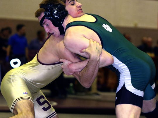 Region 3 wrestling tournament quarterfinals at Union High School Friday, Michael Acitelli of Summit (left) and Kyle Bythell of South Plainfield in 138 pound bout.