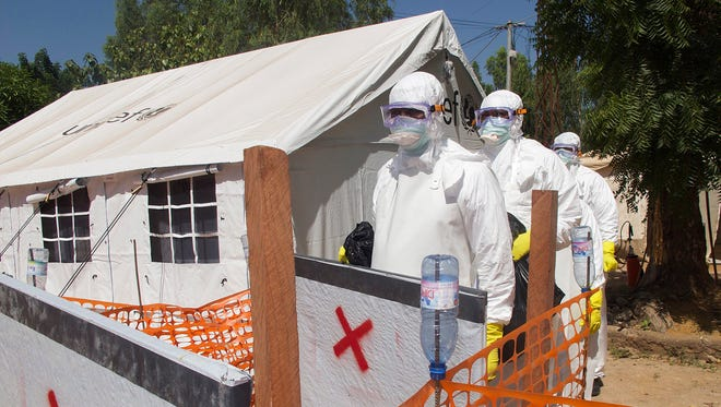 Health officials work at an Ebola isolation center in Bamako, Mali, on Nov. 11, 2014.