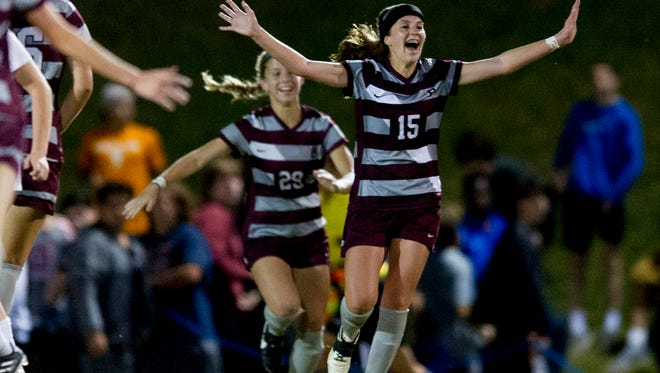 Bearden's Hailey Cartt (15) celebrates after defeating Farragut in the sectional final on Saturday, Oct. 21, 2017.