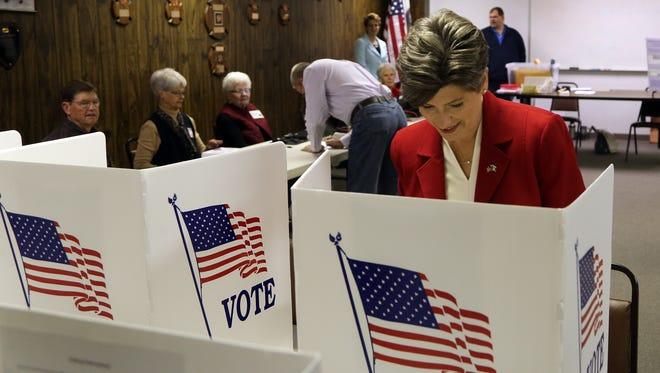 Senate candidate Joni Ernst votes in Red Oak Tuesday, Nov. 4, 2014