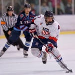 Great Falls Americans' Lucas Lomax controls the puck against the Billings Bulls on Friday at the IcePlex.