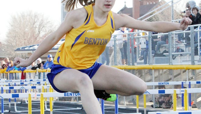 Benton's Grace Martensen clears a hurdle in the shuttle hurdle relay at the early bird meet at Benton on Monday, March 28.