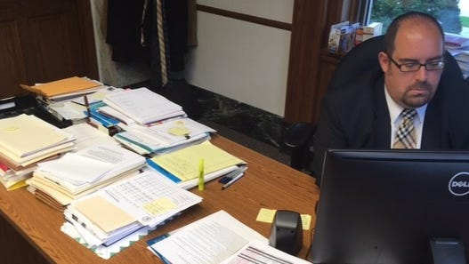 Brown County District Attorney David Lasee at work in his downtown Green Bay office in October 2016.