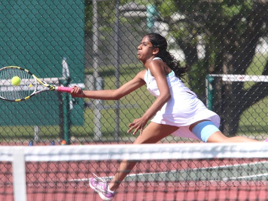 South Burlington's Sajani Sivakumar reaches for the ball during the rebels 5-2 loss to CVU in the D1 State Finals.