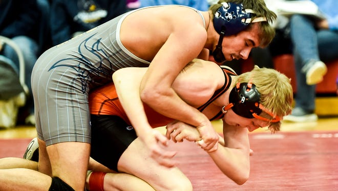 River Valley's Devin Hessler gets the top position over North Union's Trace Rasey during the MOAC Wrestling Championships at Cardington-Lincoln High School on Saturday.