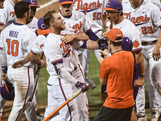 Clemson junior first baseman Seth Beer (28) celebrates a two-run home run against Florida State during the bottom of the seventh inning on Monday at Doug Kingsmore Stadium in Clemson.