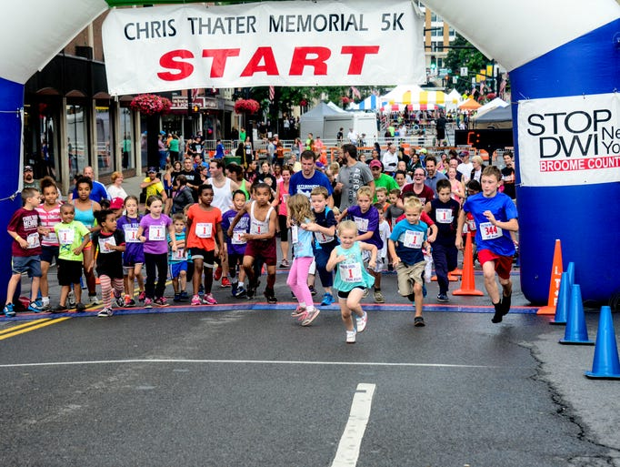 Children ran across the Court Street Bridge in Binghamton during the Chris Thater Memorial Kids Run on Saturday.