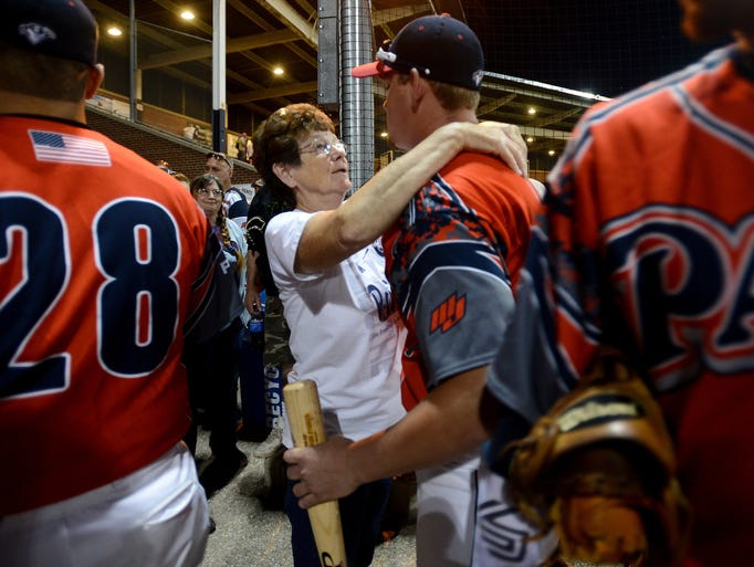 """Judy Milliken of Frankfort gives Chillicothe Paints player Dan Zuchowski a hug after they lost to the Quincy Gems in the final Prospect League championship game Wednesday. Milliken has been a host mother to several of the players including Zuchowski and said, """"We took second not first but that's alright. I'm still proud of all of them."""""""