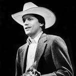 "Texas honky-tonker George Strait speaks to the audience after winning Male Vocalist of the Year during the annual CMA Awards show Oct. 14, 1985. Strait also won Album of the Year for ""Does Fort Worth Ever Cross Your Mind."""