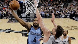 Memphis Grizzlies forward Myke Henry (4) scores past San Antonio Spurs center Pau Gasol (16) during the first half of an NBA basketball game, Monday, March 5, 2018, in San Antonio. (AP Photo/Eric Gay)