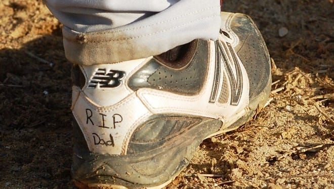 Phil Dickinson honors his father with an inscription on the back of  his cleats