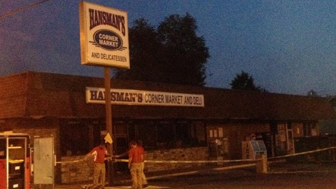 An early Monday morning fire damaged Hansman's Corner Market and Deli in Dayton, Ky.