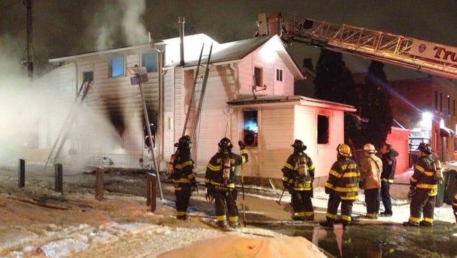 Firefighters work a blaze on Saratoga Avenue on Christmas Eve.
