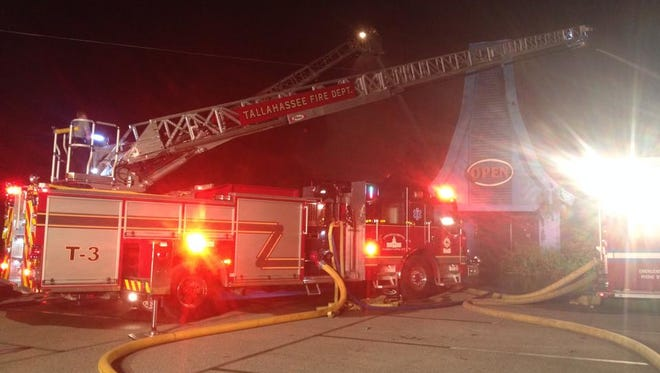 Tallahassee Fire Department crews battled a blaze at an abandoned Apalachee Parkway building Tuesday evening.