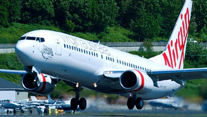 A Virgin Australia aircraft takes off in this undated photo provided by the airline.