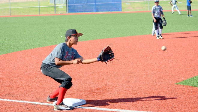 Keon Bojorquez, 12, readies himself for the tag at third base during the Cavemen baseball camp on Tuesday.