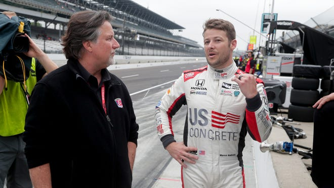 Michael Andretti and son Marco -- one of the six drivers Michael has in the 102nd Indianapolis 500 -- talk during a practice session.