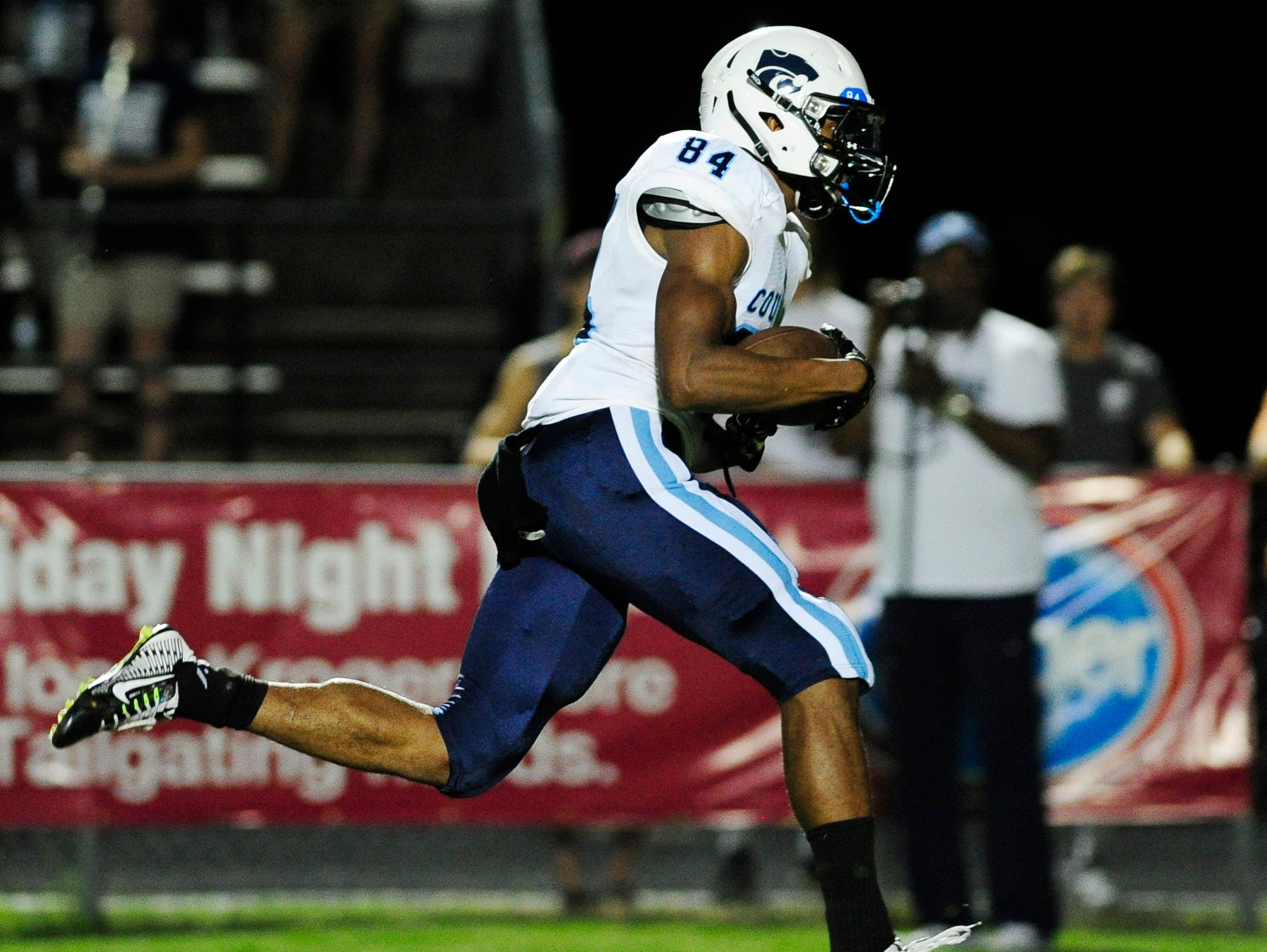 Centennial's Emanuel Hall (84) catches a pass for a touchdown on Friday.