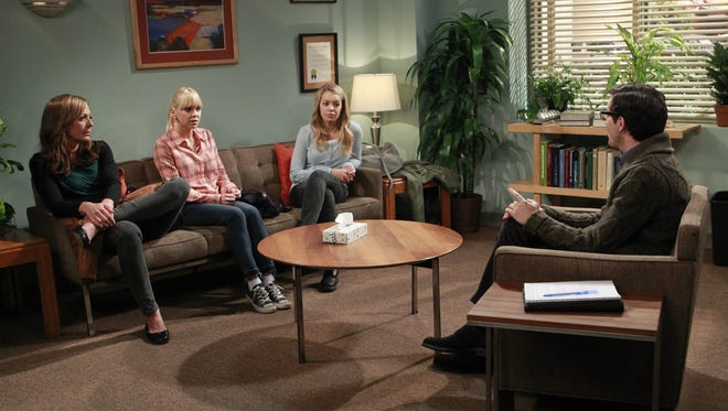 """There's laughter in the darkness,"" 'Mom' creator Chuck Lorre says of the show's take on serious subjects. ""In the bleakest moments, we have the ability to find something to laugh at."" (Pictured: Allison Janney, left, Anna Faris and Sadie Calvano)"