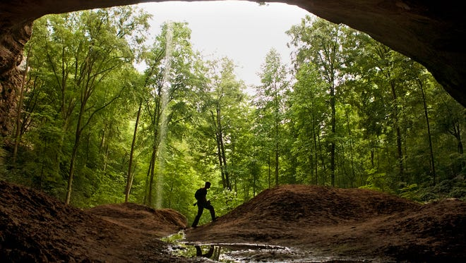 A hiker makes his way under rock formations in Red River Gorge Geological Area. June 30, 2013
