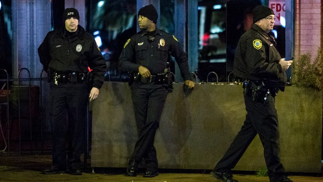 Asheville police officers stand watch across the street from a peaceful protest on Nov. 25 after the Ferguson verdict.