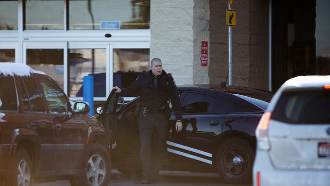 An Idaho State Patrol officer arrives at Wal-Mart in Hayden, Idaho, Tuesday, Dec. 30, 2014. A 2-year-old boy accidentally shot and killed his mother after he reached into her purse at the northern Idaho Wal-Mart and her concealed gun fired, authorities said Tuesday.