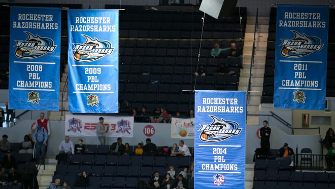The 2014 PBL Champions banner is lifted at the Razorsharks opener at the Blue Cross Arena on Dec. 6, 2014.