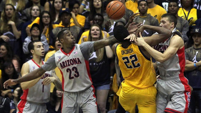 Jan. 24, 2015: Arizona Wildcats forward Rondae Hollis-Jefferson (23) and center Dusan Ristic (14) block a shot by California Golden Bears center Kingsley Okoroh (22) during the first half of their game at Haas Pavilion.