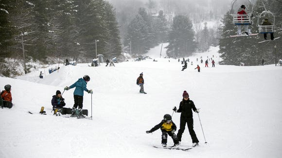 Skiers and snowboarders enjoy the fresh powder on the slopes at Wolf Ridge Ski Resort in February. Most ski areas in Western North Carolina closed this past weekend for the season.