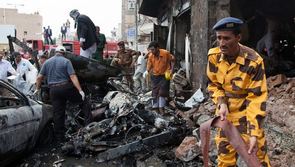 A Yemeni soldier assists in the clear up operation