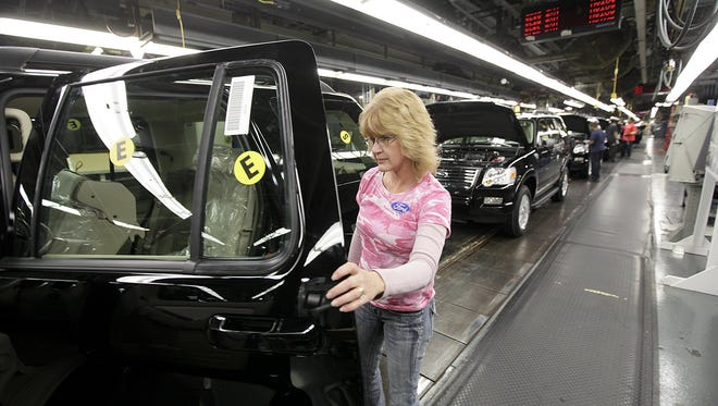 Cindy Caesar, 44, checks out the trim on a 2011 Ford Explorer at the Ford Assembly Plant in Louisville.