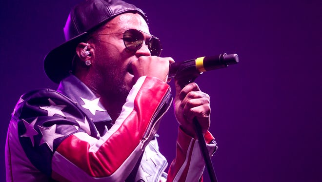 """Rapper Juicy J performs at the Quandt Fieldhouse at the University of Wisconsin - Stevens Point, Thursday, April 23, 2015. He performed such songs as his hit collaboration with Katy Perry """"Dark Horse"""" and """"Bandz A Make Her Dance."""""""