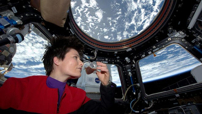 In this photo posted on Twitter, Sunday, May 3, 2015, and provided by NASA, Italian astronaut Samantha Cristoforetti sips espresso from a cup designed for use in zero-gravity, on the International Space Station. Cristoforetti, the first Italian woman in space, fired up the first espresso machine in space, which uses small capsules, or pods, of espresso coffee. (NASA via AP)