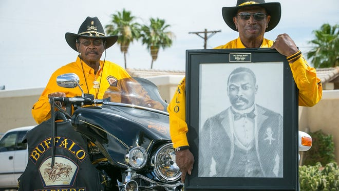 "Buffalo Soldiers Motorcycle Club members Charles ""Chaz"" Jackson, left, and Gene Hester with a photo of Medal of Honor recipient Isaiah Mays in Phoenix on Thursday, May 21, 2015."