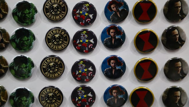 Buttons line one booth along the exhibition floor at the Wizard World Comic Con inside the Iowa Events Center in Des Moines on Saturday, June 13, 2015.