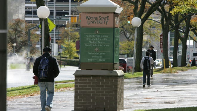 Students walk on the campus of Wayne State University in Detroit on Monday, Oct. 27, 2008.