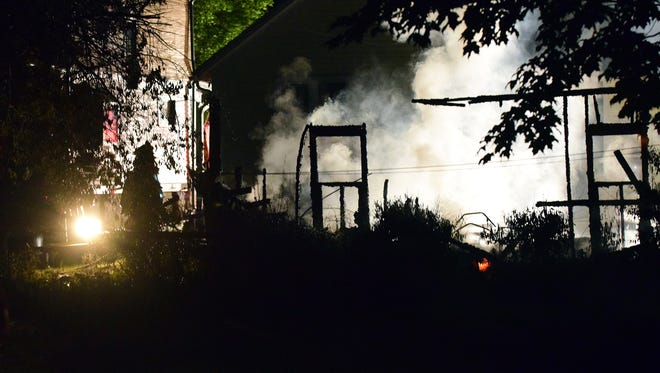 A frame is all that remains of a garage at 276 E. 1st Street in Fond du Lac early Monday morning.