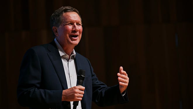 John Kasich is meeting privately with lobbyists and lawmakers on Tuesday when he visits Washington, D.C. Here, Kasich speaks in Iowa on Wednesday, June 24, 2015.