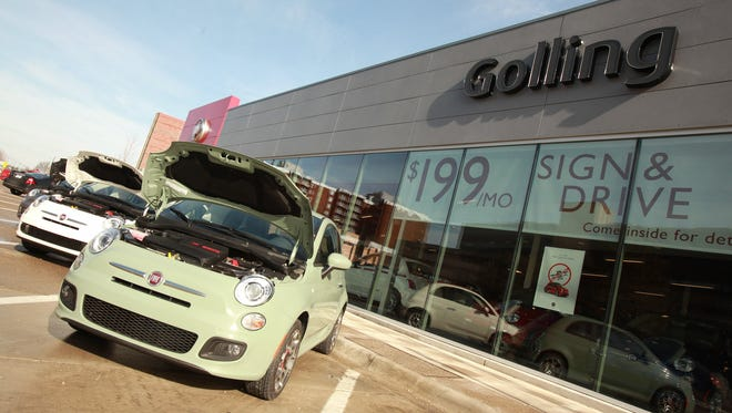 Fiats on sale at a Detroit dealership, but at least in this photo, no potential buyers. This is a 2012 file photo