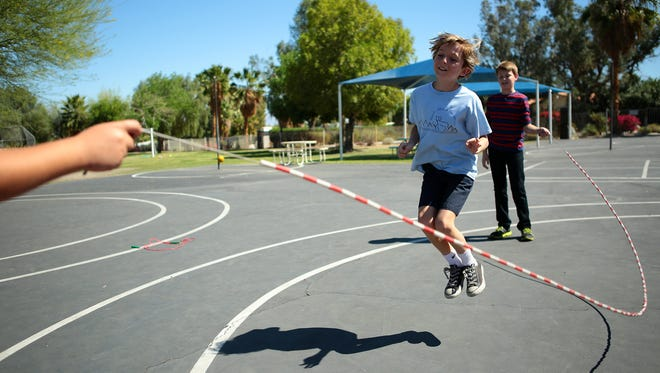 Zach Tansey, a Rancho Mirage Elementary School fifth-grader, jumps ropes with classmates.
