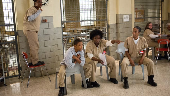 """Uzo Aduba (from left to right), Samira Wiley, Danielle Brooks and Vicky Jeudy in a scene from Netflix'?s """"?Orange is the New Black."""""""