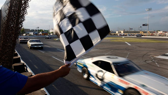 """The checkered flag flew over Richie Bloyd's car for winning a """"dromer"""" race at the Sportsdrome.  June 13, 2015."""