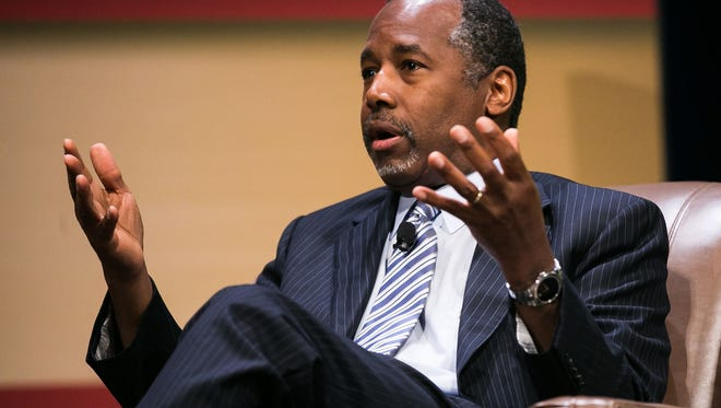Dr. Ben Carson speaks with Frank Luntz during the Family Leadership Summit in Ames on Saturday, July 18, 2015.